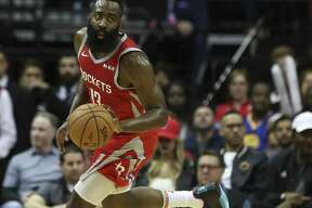 Houston Rockets guard James Harden (13) dribbles during the first quarter of the NBA game against the Golden State Warriors at Toyota Center on Thursday, Nov. 15, 2018, in Houston.