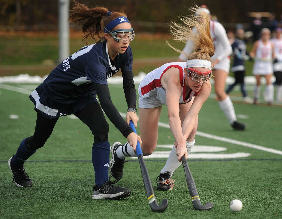 Staples' Madalaine Ambrose, left, battles for the ball with Cheshire's Mikayla Crowley during Sunday's Class L championship game in Weathersfield.