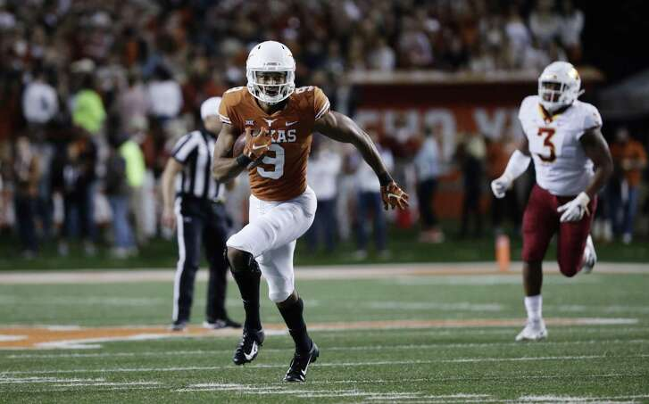 Texas wide receiver Collin Johnson (9) runs after making a catch against Iowa State during the first half of an NCAA college football game, Saturday, Nov. 17, 2018, in Austin, Texas. (AP Photo/Eric Gay)