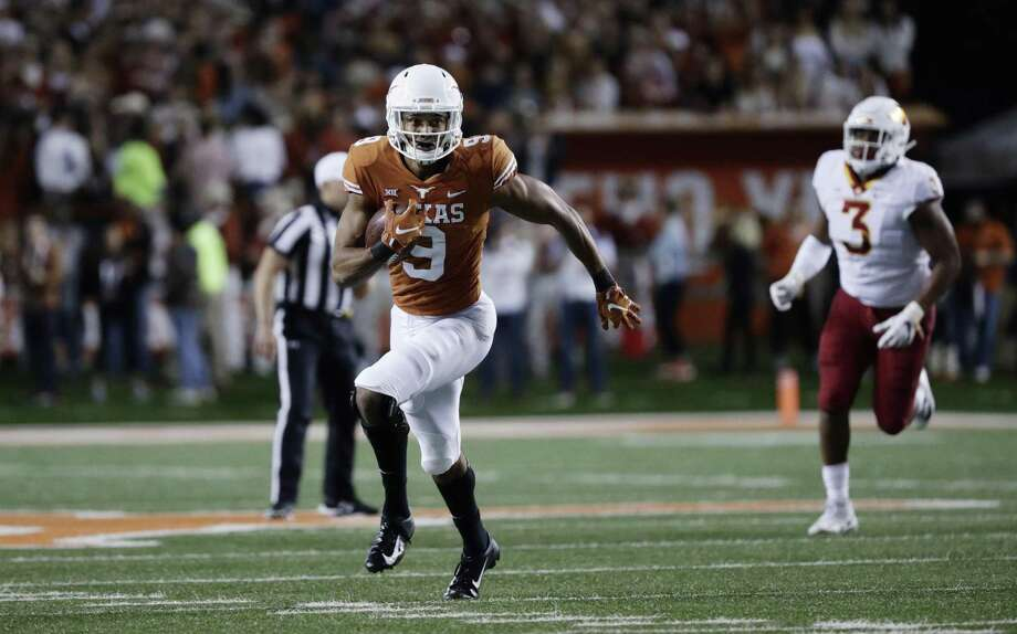 Texas wide receiver Collin Johnson (9) runs after making a catch against Iowa State during the first half of an NCAA college football game, Saturday, Nov. 17, 2018, in Austin, Texas. (AP Photo/Eric Gay) Photo: Eric Gay, STF / Associated Press / Copyright 2018 The Associated Press. All rights reserved.