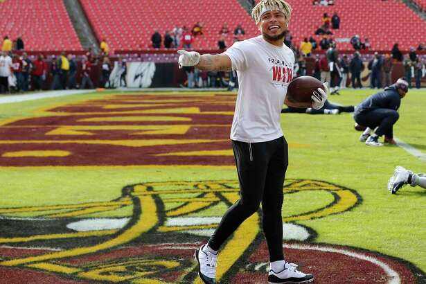 Houston Texans free safety Tyrann Mathieu talks to fans as he warms up before an NFL football game against Washington at FedEx Field on Sunday, Nov. 18, 2018, in Landover.