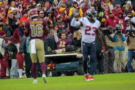 Redskins quarterback Alex Smith (11) is carted off the field after suffering an ankle injury during Sunday's game against the Texans at FedEx Field. Washington lost, 23-21.