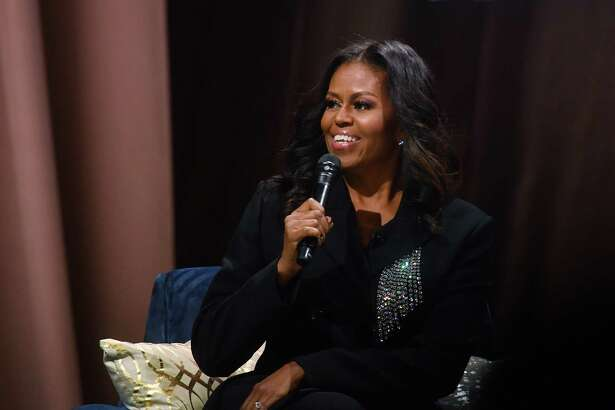 Former first lady Michelle Obama chats with the audience during a book-tour stop in Washington on Saturday.