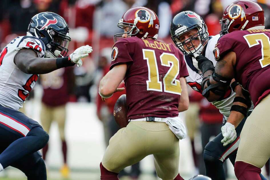 Washington quarterback Colt McCoy (12) is pressured by Houston Texans outside linebacker Whitney Mercilus (59) and defensive end J.J. Watt (99) during the fourth quarter of an NFL football game at FedEx Field on Sunday, Nov. 18, 2018, in Landover, Md.