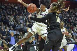 UConn's Christyn Williams (13) is fouled by Vanderbilt's Cierra Walker (10) during the second half on Saturday in Uncasville, Conn. UConn won 80-42.