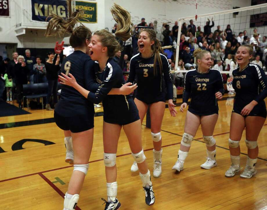 Members of the King School girls volleyball team celebrate Sunday in Stamford after match point in their 25-16, 25-20, 25-23 NEPSAC Class C Championship final win over Greens Farms Academy. Photo: King School / Contributed Photo