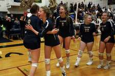 Members of the King School girls volleyball team celebrate Sunday in Stamford after match point in their 25-16, 25-20, 25-23 NEPSAC Class C Championship final win over Greens Farms Academy.