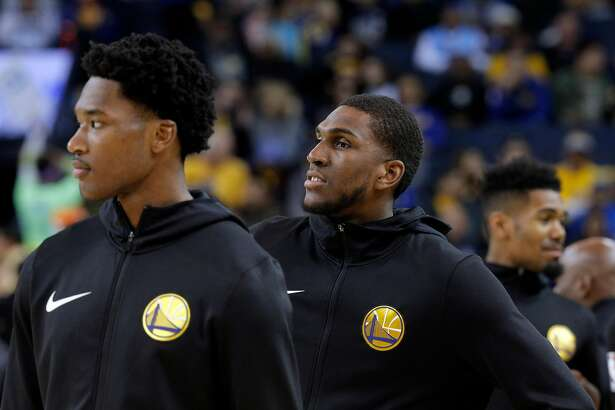 Kevon Looney (5) warms up before the Golden State Warriors game against the New Orleans Pelicans at Oracle Arena in Oakland, Calif., on Wednesday, October 31, 2018.
