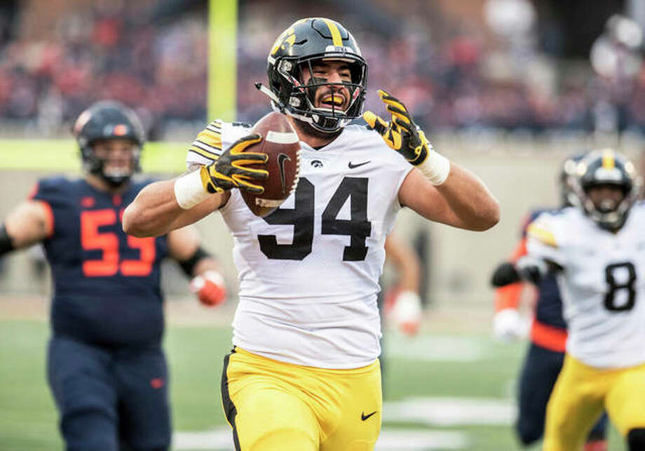 Iowa's A.J. Epenesa (94), a sophomore from Edwardsville, celebrates after returning a fumble for a TD against Illinois on Saturday in Champaign. Photo: Associated Press