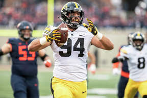 Iowa's A.J. Epenesa (94), a sophomore from Edwardsville, celebrates after returning a fumble for a TD against Illinois on Saturday in Champaign.