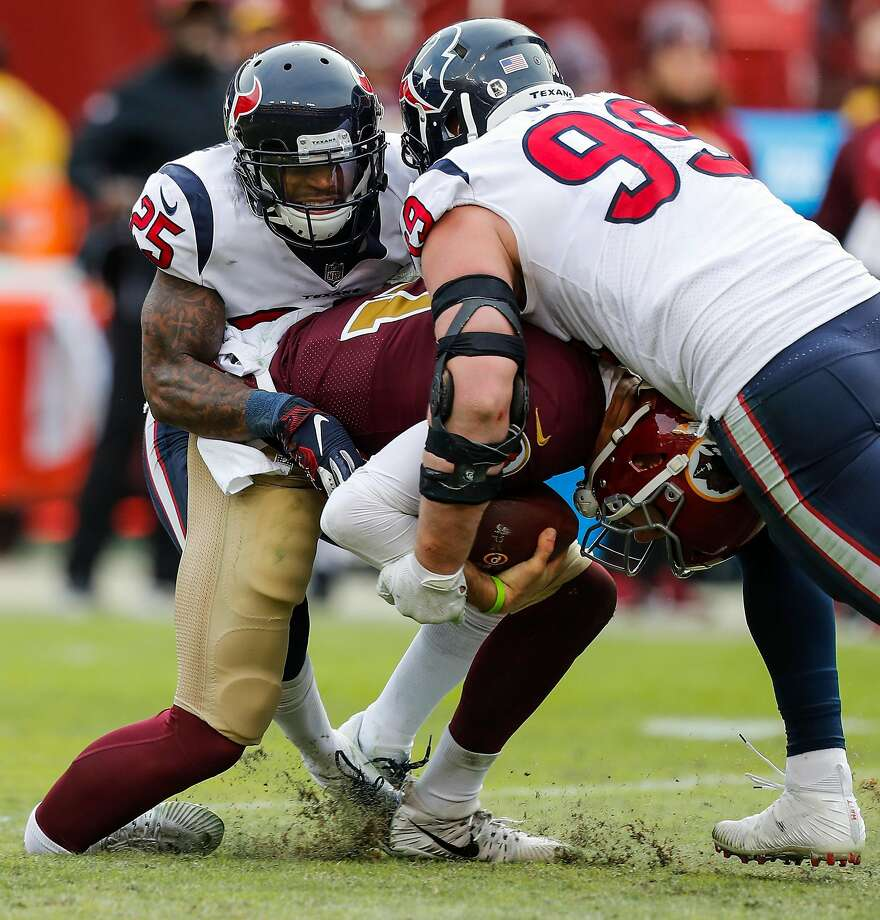 9391238a428 Houston Texans strong safety Kareem Jackson (25) and defensive end J.J.  Watt (99