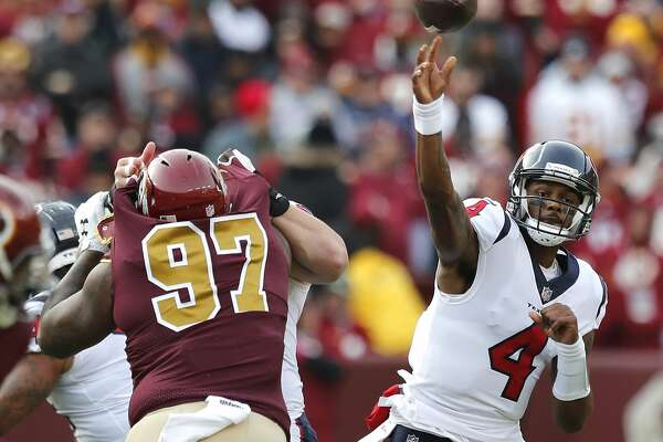 Houston Texans quarterback Deshaun Watson (4) throws a pass over Washington defensive tackle Tim Settle (97) during the first quarter of an NFL football game at FedEx Field on Sunday, Nov. 18, 2018, in Landover.