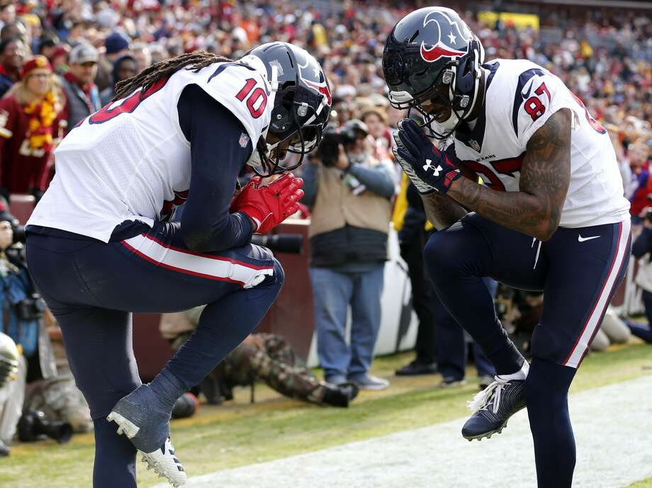 PHOTOS: What to know about Demaryius Thomas  Houston Texans wide receivers DeAndre Hopkins (10) and Demaryius Thomas (87) celebrate Hopkins' 16-yard touchdown reception against Washington during the first quarter of an NFL football game at FedEx Field on Sunday, Nov. 18, 2018, in Landover. >>>Browse through the gallery for a closer look at the Texans' newest wide receiver ...  Photo: Brett Coomer/Staff Photographer