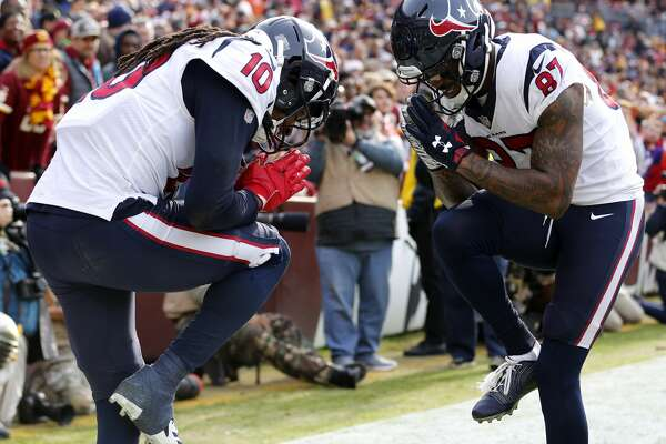 Houston Texans wide receivers DeAndre Hopkins (10) and Demaryius Thomas (87) celebrate Hopkins' 16-yard touchdown reception against Washington during the first quarter of an NFL football game at FedEx Field on Sunday, Nov. 18, 2018, in Landover.