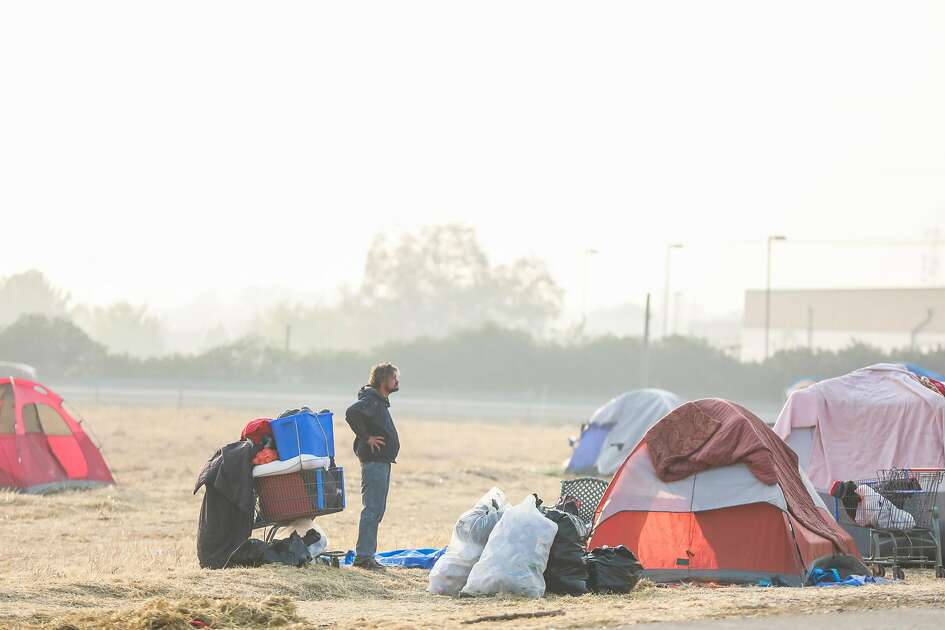 The air is hazy outside Walmart which is being used as a makeshift evacuation site for Camp Fire evacuees in Chico, California, on Sunday, Nov. 18, 2018.