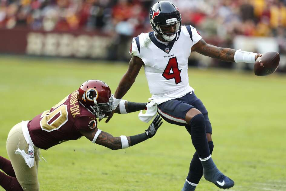 Houston Texans quarterback Deshaun Watson (4) is pushed out of bounds by Washington free safety Ha Ha Clinton-Dix (20) during the third quarter of an NFL football game at FedEx Field on Sunday, Nov. 18, 2018, in Landover, Md.