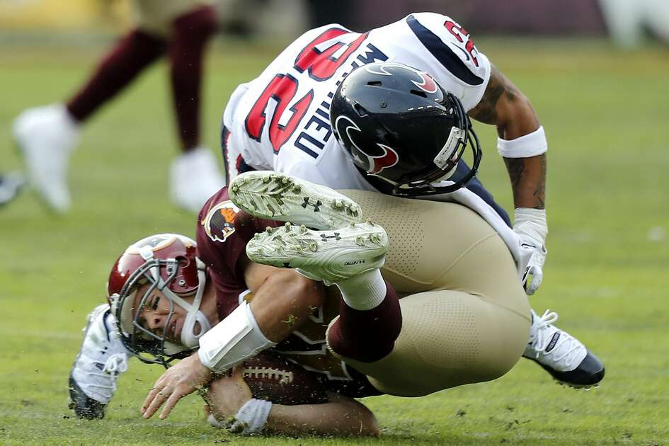 Houston Texans free safety Tyrann Mathieu (32) stops Washington quarterback Colt McCoy (12) during the third quarter of an NFL football game at FedEx Field on Sunday, Nov. 18, 2018, in Landover, Md.