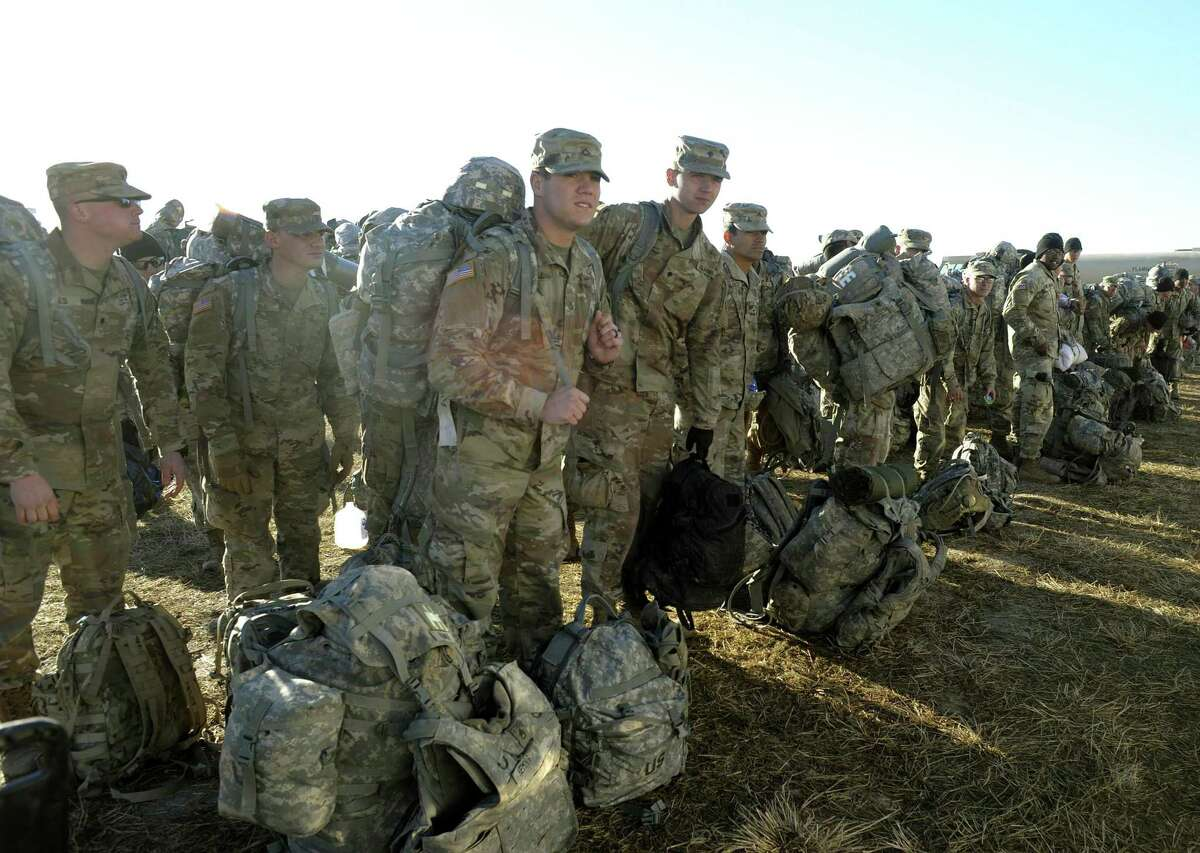 Members of the 541st Sapper Company prepare for an assignment at Camp Donna, adjacent to the Donna Rio Bravo port-of-entry, on Thursday, Feb. 15, 2018. They were preparing to board busses for a three-hour trip to Laredo, where they were to place concertina wire at the international bridge.