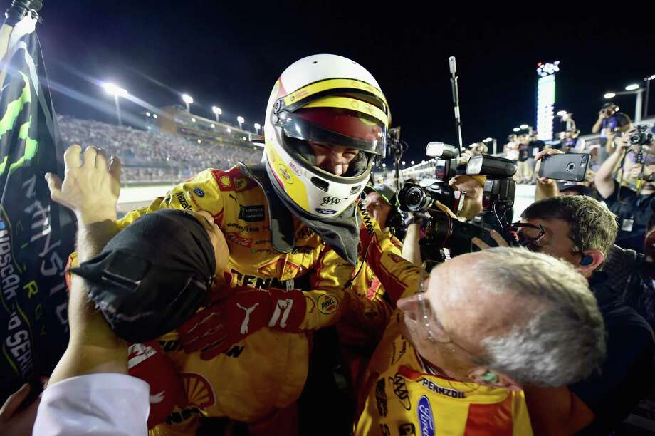 Joey Logano, driver of the #22 Shell Pennzoil Ford, celebrates after winning the Monster Energy NASCAR Cup Series Ford EcoBoost 400 at Homestead-Miami Speedway on November 18, 2018 in Homestead, Florida. Photo: Jared C. Tilton, Stringer / Getty Images / 2018 Getty Images