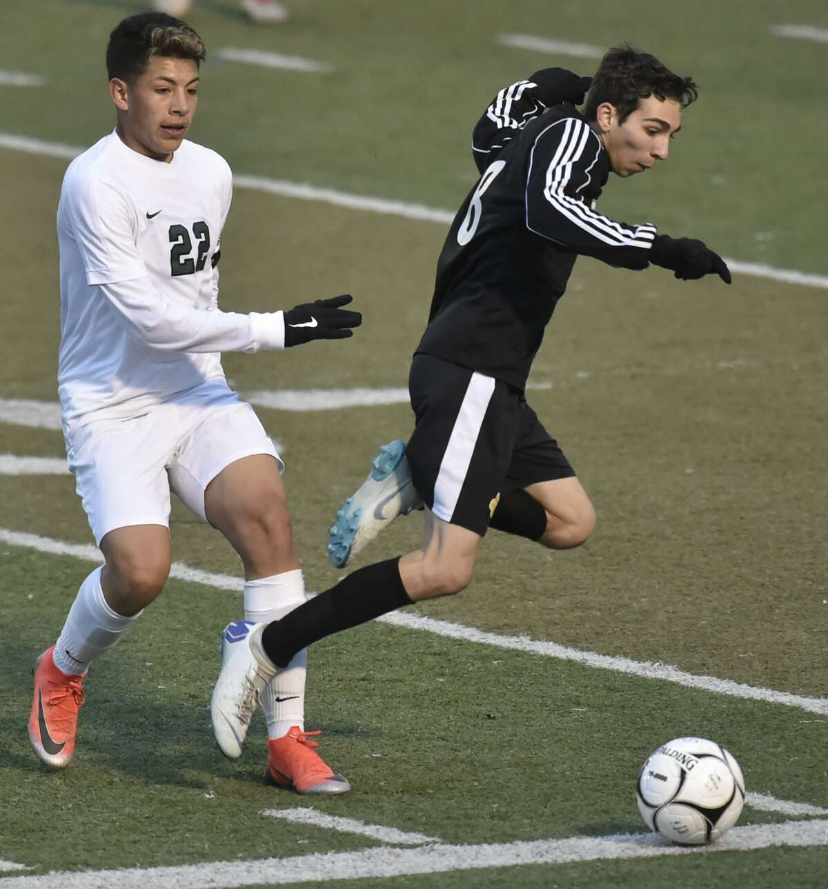 Middletown, Connecticut - November 18, 2018: Daniel Hand H.S. of Madison vs. Maloney H.S. of Meriden during the second-half of the CIAC 2018 State Boys Class L Soccer Tournament Finals Sunday at Middletown High School. Daniel Hand H.S. defeats Maloney H.S. 1-0.