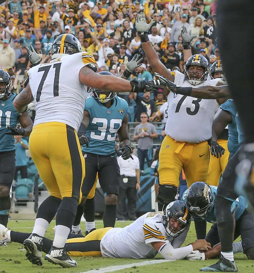 3ce33601924 Steelers quarterback Ben Roethlisberger dives across the goal line to score  the winning touchdown in Jacksonville