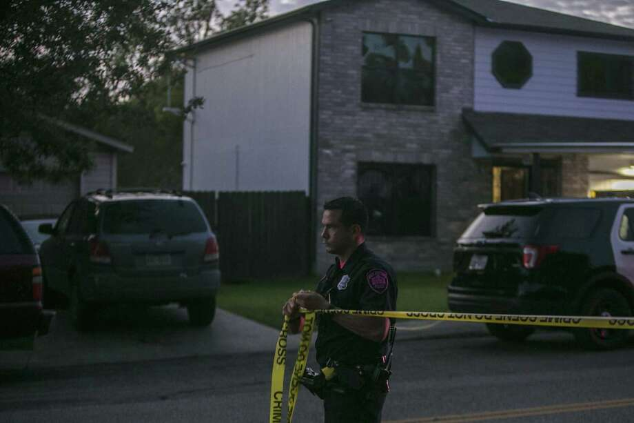 A San Antonio Police Officer puts up polce tape at the scene of a shooting on the 4000 block of Mystic Sunrise in San Antonio, Thursday, Oct. 25, 2018. One person has been confirmed dead and two others were taken to the hospital for treatment. Photo: Josie Norris, Staff / San Antonio Express-News / © San Antonio Express-News