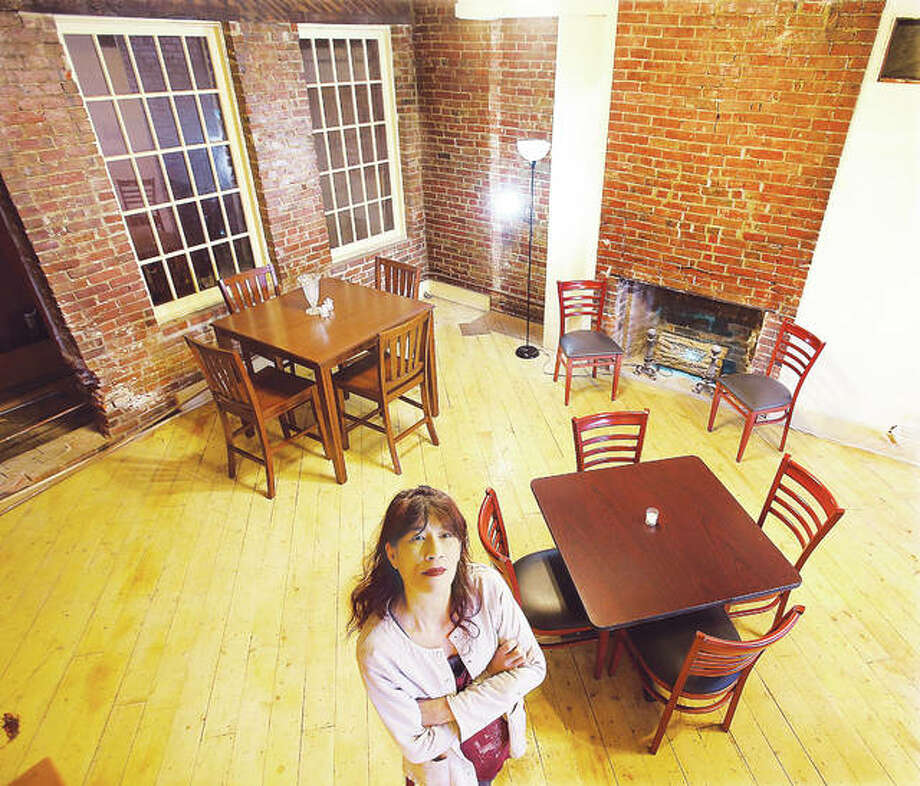 Nora Zimmerman, co-owner of Gatsby's Grille on State Street in downtown Alton along with Scott Ramage, stands in the second floor dining area of the building, which last housed the Big Muddy Pub.