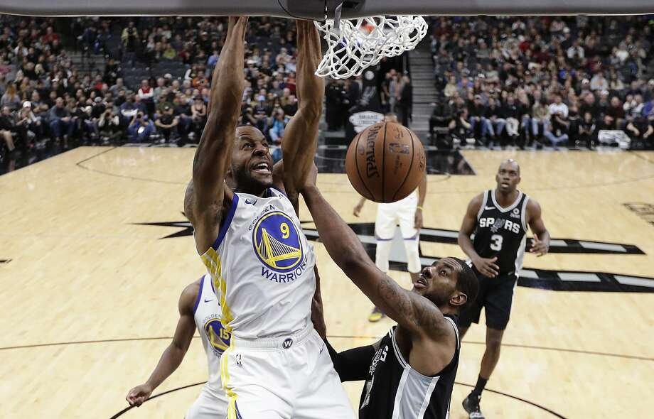 Golden State Warriors guard Andre Iguodala (9) scores over San Antonio Spurs forward LaMarcus Aldridge (12) during the first half of an NBA basketball game Sunday, Nov. 18, 2018, in San Antonio. (AP Photo/Eric Gay) Photo: Eric Gay, Associated Press