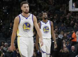 Golden State Warriors forward Kevin Durant (35) and guard Klay Thompson (11) walk off the court during a timeout during the first half of an NBA basketball game San Antonio Spurs, Sunday, Nov. 18, 2018, in San Antonio. (AP Photo/Eric Gay)