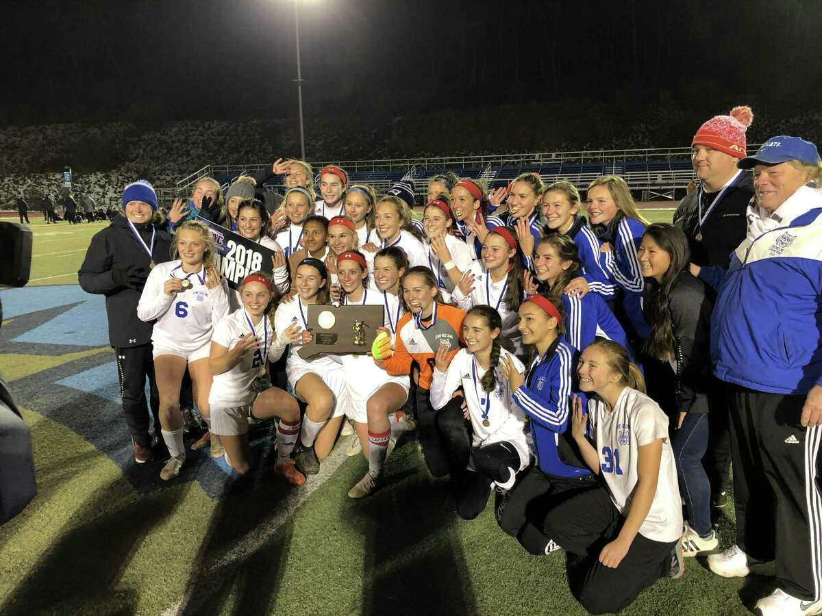Members of the Old Lyme girls soccer team celebrate their win in the Class S championship game on Sunday.