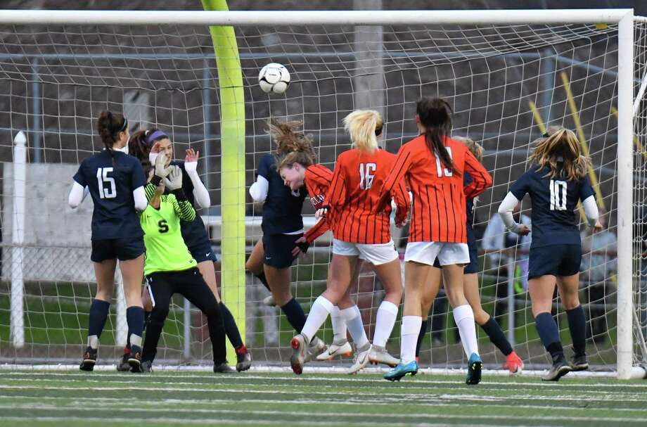 Megan Klosowski, center, of Ridgefield High scores on a header off Faith Arnold's corner kick for the only goal in the Class LL soccer championship Staples Sunday at West Haven High. The Tigers repeated as champs by beating Staples, 1-0. Photo: Gregory Vasil / For Hearst Connecticut Media / Connecticut Post Freelance