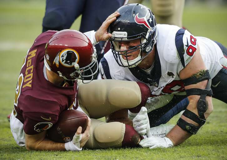 Houston Texans defensive end J.J. Watt (99) sacks Washington quarterback Colt McCoy (12) during the fourth quarter of an NFL football game at FedEx Field on Sunday, Nov. 18, 2018, in Landover, Md.