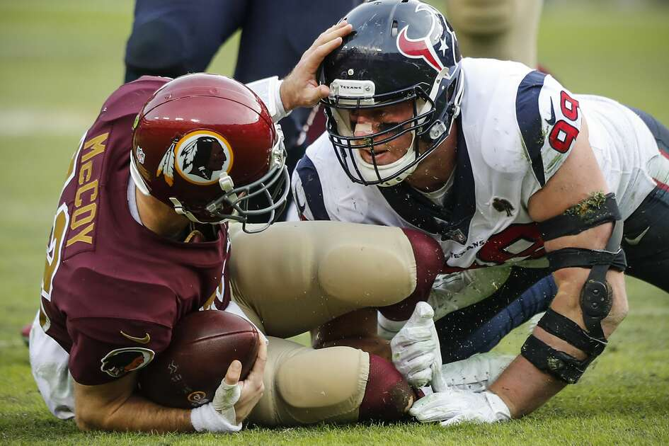 Houston Texans defensive end J.J. Watt (99) sacks Washington quarterback Colt McCoy (12) during the fourth quarter of an NFL football game at FedEx Field on Sunday, Nov. 18, 2018, in Landover, Md.