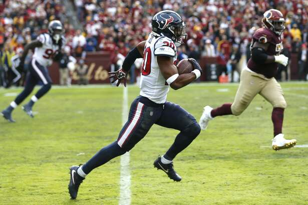 Houston Texans strong safety Justin Reid (20) runs the ball out of the end zone as returns an interception of a pass by Washington quarterback Alex Smith 101 yards for a touchdown during the second quarter of an NFL football game at FedEx Field on Sunday, Nov. 18, 2018, in Landover, Md.