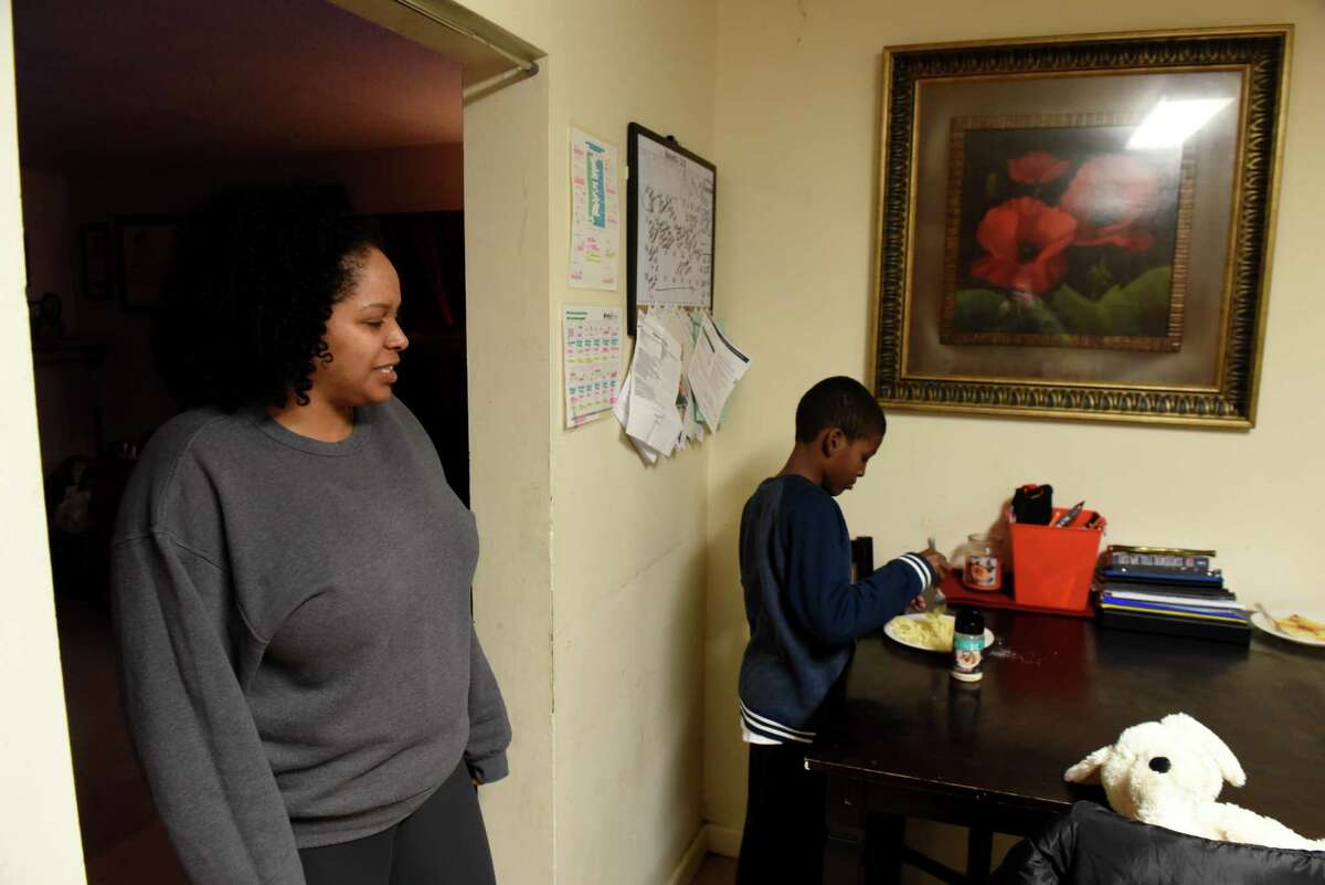 Dalila Yeend with her son, Taki Evans, 9, at their home on Wednesday, Nov. 14, 2018, in Troy, N.Y. Yeend, a single mother and domestic violence survivor, can't receive cash public benefits while she's applying for a green card to legalize her undocumented immigration status. The federal government has proposed tightening restrictions on which immigrants receiving public benefits are eligible to apply for green cards - expanding the definition to include non-cash benefits like food stamps. (Will Waldron/Times Union)