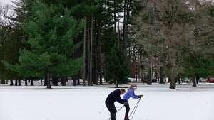 Brook Maliszewski, a Saratoga Springs High School senior and member of the cross country ski team and her father, Geoff Maliszewski, work out of their skis on Sunday, Nov. 18, 2018, in Saratoga Springs, N.Y.    (Paul Buckowski/Times Union)