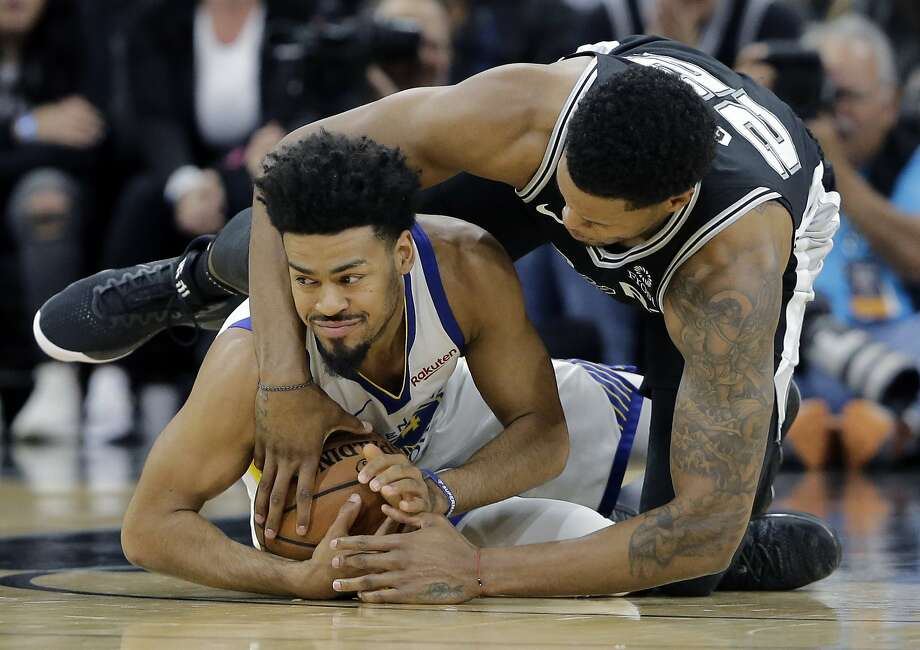 Golden State Warriors guard Quinn Cook, left, and San Antonio Spurs forward Rudy Gay, right, scramble for the ball during the first half of an NBA basketball game Sunday, Nov. 18, 2018, in San Antonio. (AP Photo/Eric Gay) Photo: Eric Gay / Associated Press