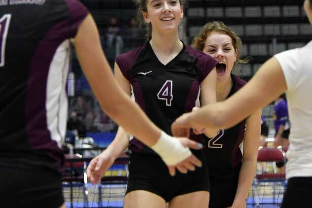 Burnt Hills-Ballston Lake's Claire Isaksen (4) and Sofia Pawlusik cheer after their team scored a point during the Class A state semifinal pool play game against Niagara Wheatfield on Sat., Nov. 17, 2018 at Cool Insuring Arena in Glens Falls, N.Y. (Jenn March, Special to the Times Union, Post-Star)