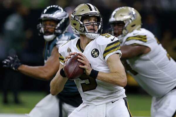 NEW ORLEANS, LOUISIANA - NOVEMBER 18: Drew Brees #9 of the New Orleans Saints throws the ball for a touchdown during the first half against the Philadelphia Eagles at the Mercedes-Benz Superdome on November 18, 2018 in New Orleans, Louisiana. (Photo by Jonathan Bachman/Getty Images)