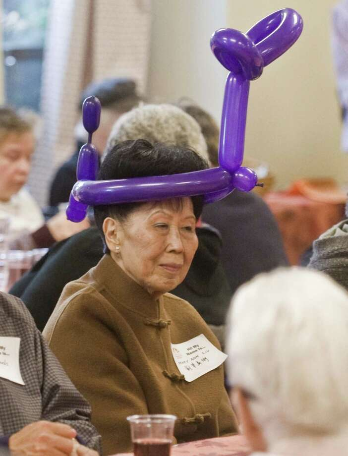 Mary Ann Liu, of Norwalk, waits for her table to be called for the buffet at the Community Thanksgiving Luncheon held at the Cornerstone Community Church. Sunday, Nov. 18, 2018 Photo: Scott Mullin / For Hearst Connecticut Media / The News-Times Freelance