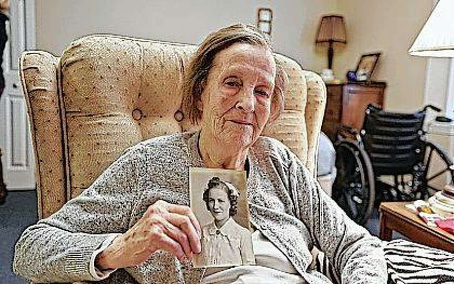 Lorriane Baer, 99, holds a photo of herself and talks about her time as a Army nurse in World War II at her home in Decatur. During the war it was patriotic duty to serve the war effort in some way. For many of the men, that was putting on a uniform and going to fight. For a lot of women, it meant joining the women's branches of each armed service, which were separate then. H. Lorraine Eades, as she was known then, was finishing up nursing school at John C. Proctor Hospital in Peoria when an Army recruiter came to visit and asked the students if they would serve. Photo: Clay Jackson | Herald & Review (AP)