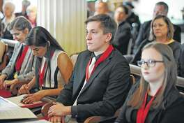 Charles K. Monge from Illinois College (center) listens to speakers during Saturday's Student Laureate cerermony.