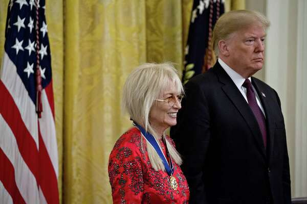 Miriam Adelson, philanthropist and wife of billionaire Sheldon Adelson (left) stands next to Donald Trump after being presented the Presidential Medal of Freedom during a ceremony in the East Room of the White House in Washington, D.C., on Nov. 16, 2018.
