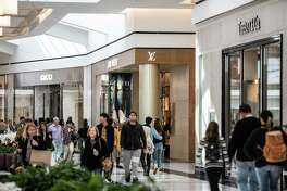 Shoppers walk through the King of Prussia mall in King of Prussia, Pa., on Oct. 20, 2018.