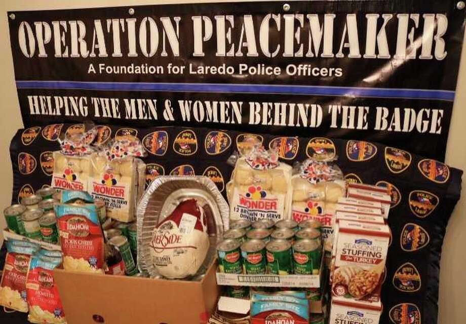 Operation Peacemaker has created 24 meal kits for Laredo families in need just in time for the holiday. Keep scrolling to see scenes from last year when Laredo Police handed out turkeys instead of traffic citations: Photo: Courtesy Operation Peacemaker