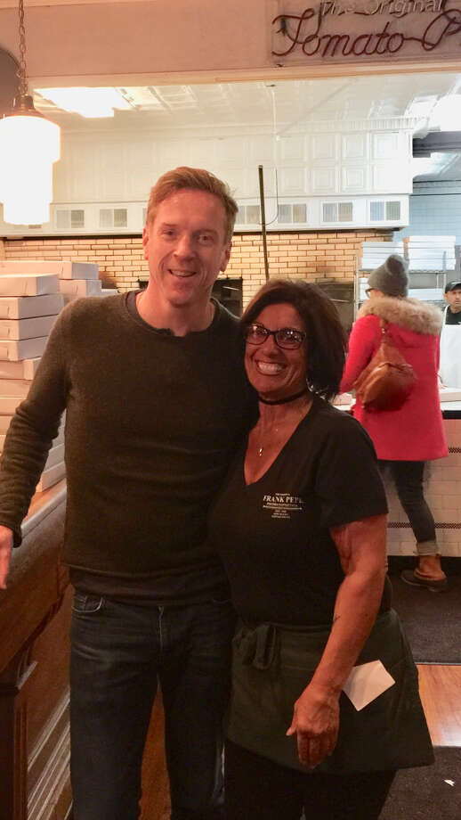 """""""Billions"""" actor Damian Lewis posed for a photo with Frank Pepe Pizzeria Napoletana server Gina Merola on Sunday, Nov. 18, 2018 after stopping by for a family dinner with his aunt and uncle. Photo: Contributed By Skye Stewart"""