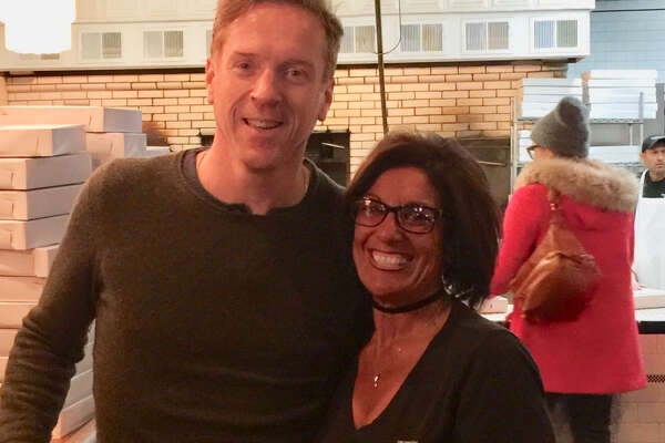 """""""Billions"""" actor Damian Lewis posed for a photo with Frank Pepe Pizzeria Napoletana server Gina Merola on Sunday, Nov. 18, 2018 after stopping by for a family dinner with his aunt and uncle."""