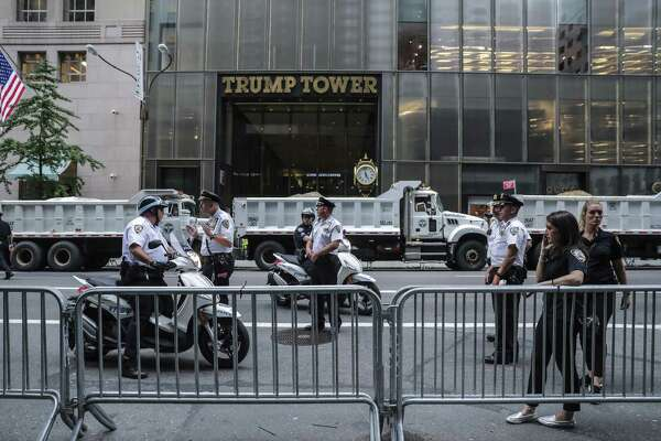 New York Police Department (NYPD) officers stand guard during a rally outside of Trump Tower in New York on Aug. 14 , 2017.