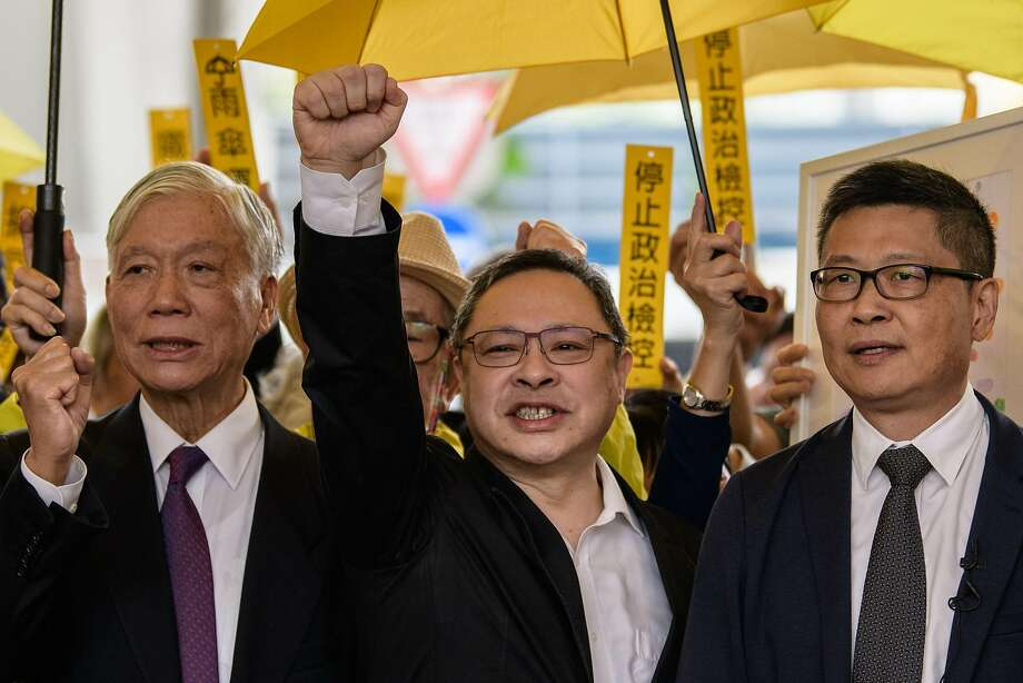 Retired pastor Chu Yiu-ming (left), law Professor Benny Tai (center) and sociology Professor Chan Kin-man enter the courthouse in Hong Kong. Photo: Anthony Wallace / AFP / Getty Images