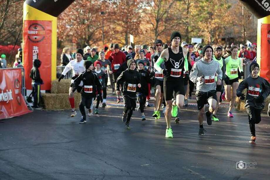 Runners take part in last year's Turkey Trot on the morning of Thanksgiving. It's a relatively short event, as the awards for the 5K typically take place by 9:45 a.m. Photo: For The Intelligencer